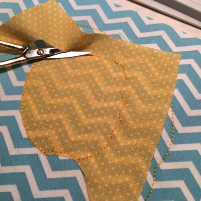 Applique fabric being trimmed