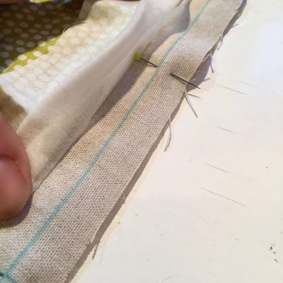 Blocks pinned together along stitching line