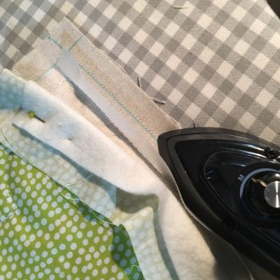 Press the stitched seam with a mini iron