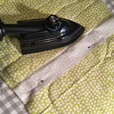 Use the mini iron to fuse the backing to the batting