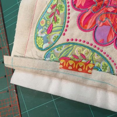 Quilt fabric folded back to expose batting