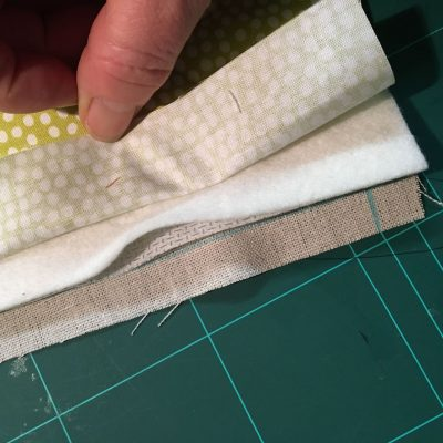 Quilt batting level with stitching line