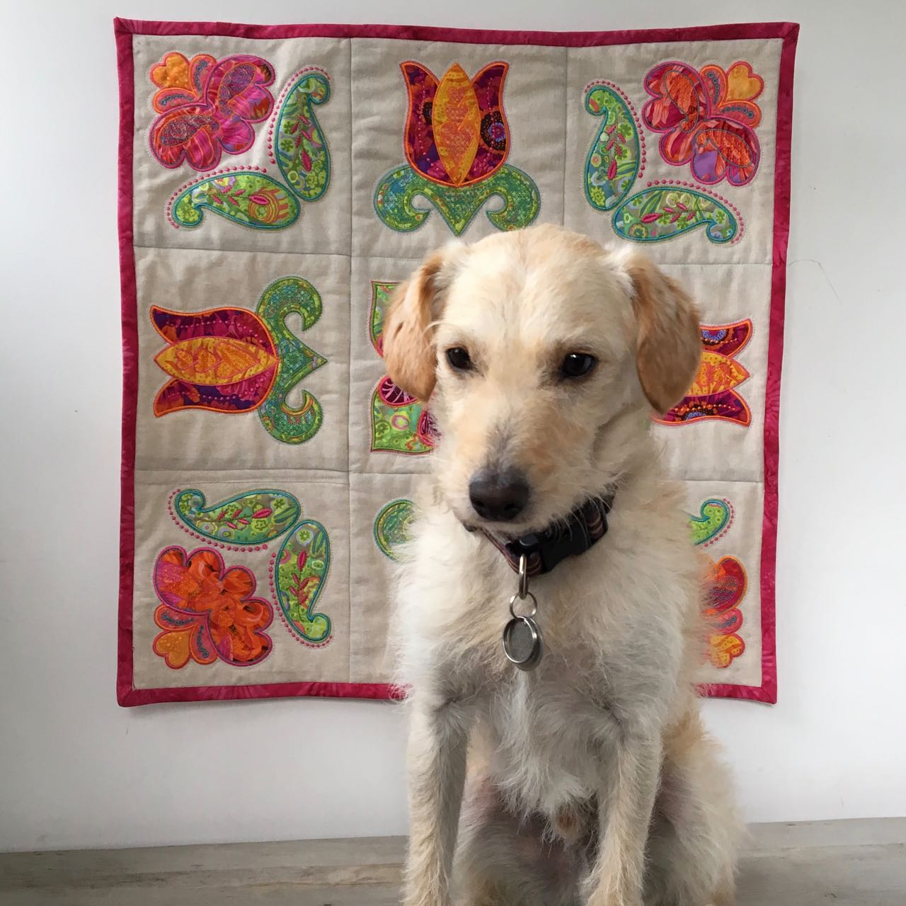Wall quilt with Bob the dog.