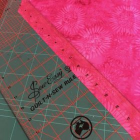 Cutting bias strips with ruler and rotary cutter