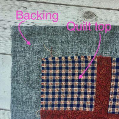 Quilt backing extends beyond quilt top
